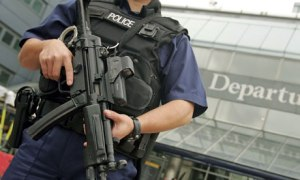 armed police officer patrols outside Heathrow airport